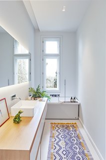 Dwell's Top 10 Bathrooms of 2017 - Photo 1 of 10 - Designed by Hungarian studio POSITION Collective, this 2,099-square-foot, two-story villa on Rezeda Street in the Pest area of Budapest is home to a family of four. Within, herringbone wood floors, geometric details on the ceilings, quirky lighting, furniture with interesting textures and colors, and framed artwork and photography come together to create a jaw-dropping contemporary home.
