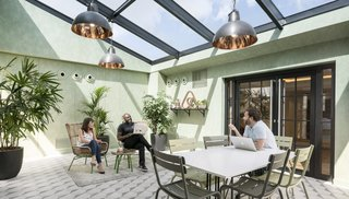 8 Modern Offices That Feel Like Homes - Photo 5 of 8 - As a company that knows the importance of feeling at home, Airbnb's Paris office was inspired by the city's attic lofts and includes a solarium and roof garden.