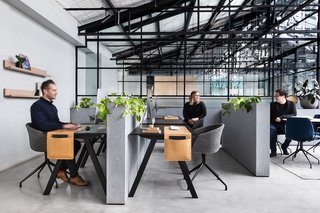 8 Modern Offices That Feel Like Homes - Photo 4 of 8 - An Art Deco warehouse conversion in Melbourne is home to two creative enterprises that share a common boardroom, kitchen, and break space.