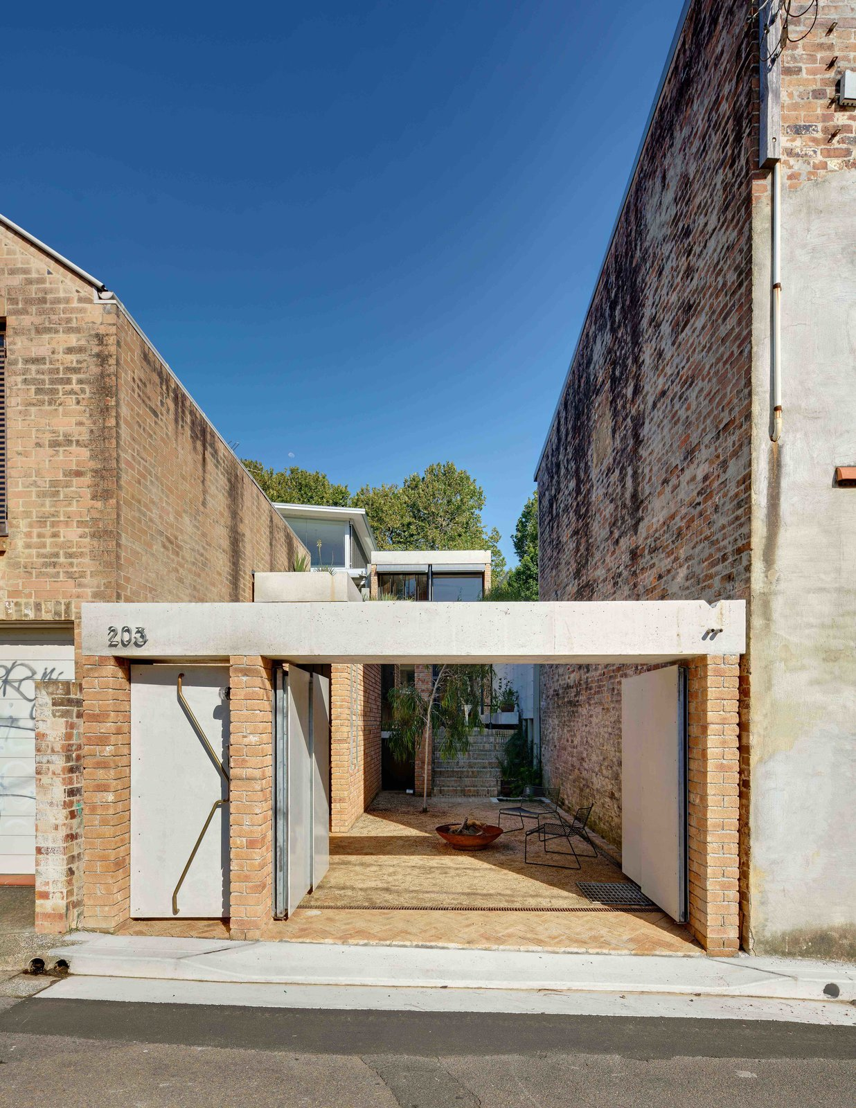 Tagged: House, Brick, Concrete, Outdoor, and Front Yard.  Best Outdoor Front Yard Brick Photos from Find Out How Light and Precious Outdoor Space Were Introduced to an Old Australian Cottage