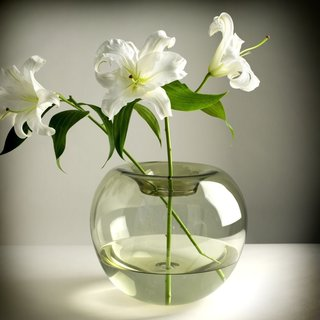 12 Modern Ways to Decorate With Flowers - Photo 2 of 7 - Since glass is such a contemporary material, flowers immediately take on a streamlined and modern appeal when they're paired with it. The Stamen Glass Vase by Niche Modern is one example of a minimalist, blown-glass vessel that's ideal for delicate flowers. Stick with freshly cut blooms for an elegant look.