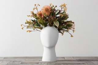 12 Modern Ways to Decorate With Flowers - Photo 7 of 7 - Inspired by Amedeo Modigliani portraits, the glazed ceramic Wig Flower Vase by designer Tania da Cruz is a great addition to your dressing, dining, or side table, and a guaranteed conversation piece.