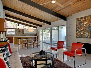 Experience A Blast From The Past At One Of These Midcentury-Modern Palm Springs Vacation Homes - Photo 2 of 8 - Another Krisel-designed property, this restored midcentury modern built by the Alexander Construction Co. in 1959 has vaulted tongue and groove ceilings and porcelain tile floors, and is furnished with classic designers from Warren Platner, George Nelson and the Eames, and vintage midcentury abstract paintings.