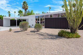 Experience A Blast From The Past At One Of These Midcentury-Modern Palm Springs Vacation Homes - Photo 5 of 8 - With polished concrete floors, post and beam ceilings, and an open floor plan, this Krisel-designed Alexander in Racquet Club Estates has a home theater,  newly renovated kitchen, a private backyard that offers spectacular mountain views, and is just minutes from downtown restaurants and bars.