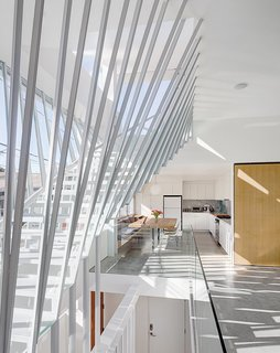 10 Best Modern Homes in Venice Beach, California - Photo 9 of 10 - Architect Don Dimster designed this duplex as two family homes—one for him and his family, and one for his brother and his family. A pair of glass-walled, suspended-steel stairways connect both homes to a shared 1,000-square-foot rooftop patio.