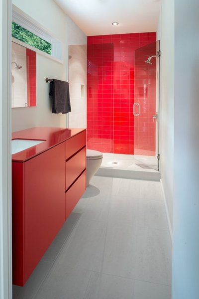 The most popular type of market theses days, free standing vanities with built-in storage like this red powder-coated Kohler vanity with drawers and cabinets, are ideal for keeping toilet rolls, toiletries and other bathroom necessities out of sight.