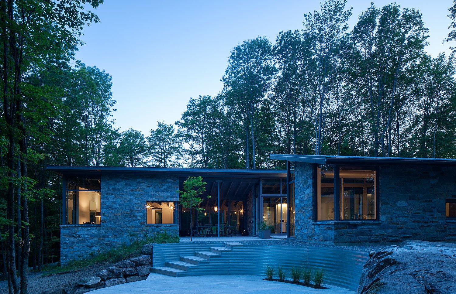 7 Incredible Modern Homes by Canadian Architect Paul Bernier - Photo 3 of 7 - The boundaries between the indoors and outdoors are blurred with breakthroughs and a massive window on the southeast corner that presents stunning diagonal views of the forest.