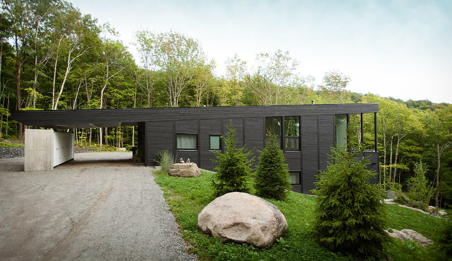 7 Incredible Modern Homes by Canadian Architect Paul Bernier - Photo 4 of 7 - Cedar planks on the exterior walls are dyed black. On the indoor walls, the cedar planks are dyed white.