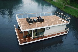 6 Modular Houseboat and Floating Home Manufacturers Around the World - Photo 1 of 6 - Based in the Czech Republic, No 1 Living builds houseboats with an upper and lower deck and glazed interiors that take advantage of outdoor views. Founded in 2013, they offer two models of houseboats: the No1 Living 40-foot model and the larger No1 Living 47-foot model. Both are equipped with a kitchen, full bathroom, bedrooms, and generous storage space. The houses are built with durable, anticorrosion-protected steel and polyethylene-segmented floats, which guarantee excellent floatation.