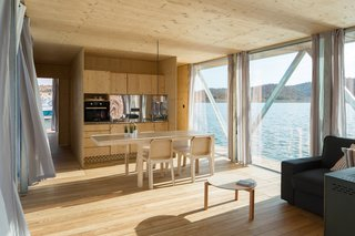 6 Modular Houseboat and Floating Home Manufacturers Around the World - Photo 3 of 6 - With a background in engineering and technologically-advanced water leisure devices and equipment, Go Friday can help you plan and design a modular floating home that's not only beautiful, but also environmentally sustainable and energy efficient. Their designs have a fixed width of approximately 20 feet and lengths that range from 32.8 to 59 feet. The shorter options are ideal for cozy studios, while longer options can fit three bedrooms.