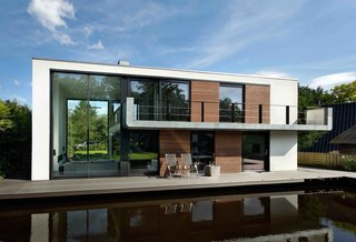 6 Modular Houseboat and Floating Home Manufacturers Around the World - Photo 6 of 6 - About 90 percent of the world's largest cities are located along waterfronts. Koen Olthuis of Dutch architectural firm Waterstudio.NL believes that with climate change leading to drastic rises in sea levels, we'll need to rethink how we live with water in the built environment. His team has designed sophisticated floating homes like Watervilla De Hoef and Watervilla IJburg in the Netherlands, and is working on masterplans for floating apartments, social housing developments, and even cities.