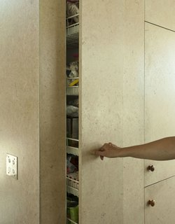 9 Great Kitchen Cabinet Ideas - Photo 4 of 9 - Blending in with the fiberboard walls, the MDF doors in this kitchen hide a pull-out storage system that serves as a kitchen pantry.