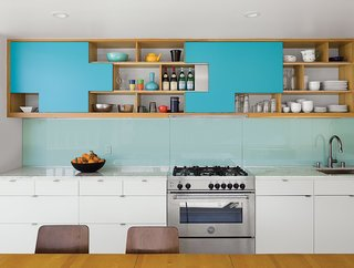 9 Great Kitchen Cabinet Ideas - Photo 9 of 9 - In this Palm Springs duplex, the architect-owner got creative with the cabinet doors by designing aqua blue plywood sliders that park at specific positions, fitting together like puzzle pieces. Contractor Franklin Pineda custom-built the cabinets using Baltic birch plywood from Anderson Plywood.