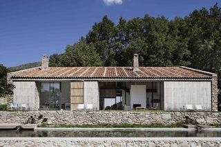 An Abandoned Stable in Spain Is Transformed Into a Sustainable Vacation Home For Rent - Photo 1 of 13 -
