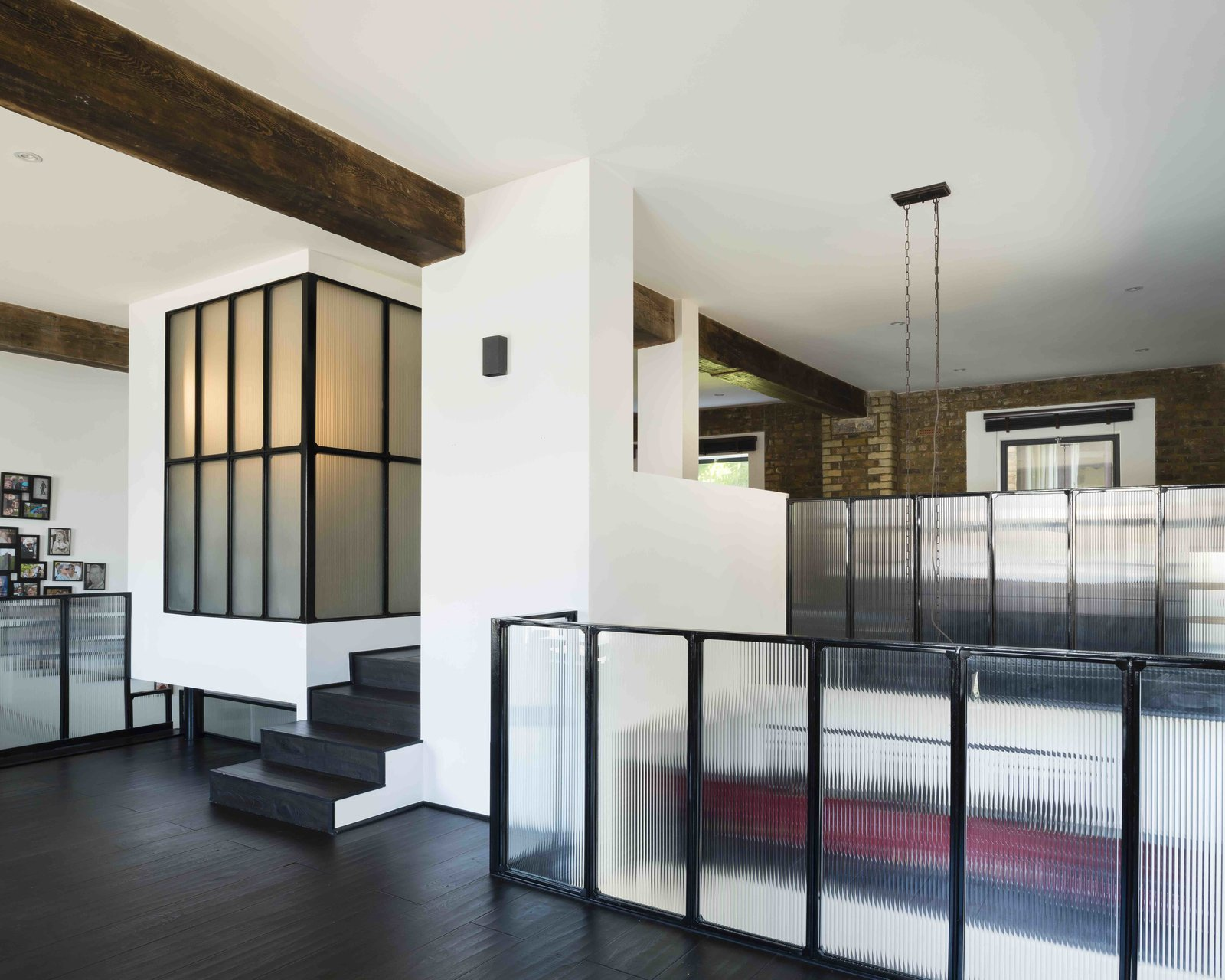 Tagged: Hallway and Dark Hardwood Floor.  Photo 1 of 12 in An Old Grain Warehouse on the River Thames Is Transformed Into an Industrial-Modern Home