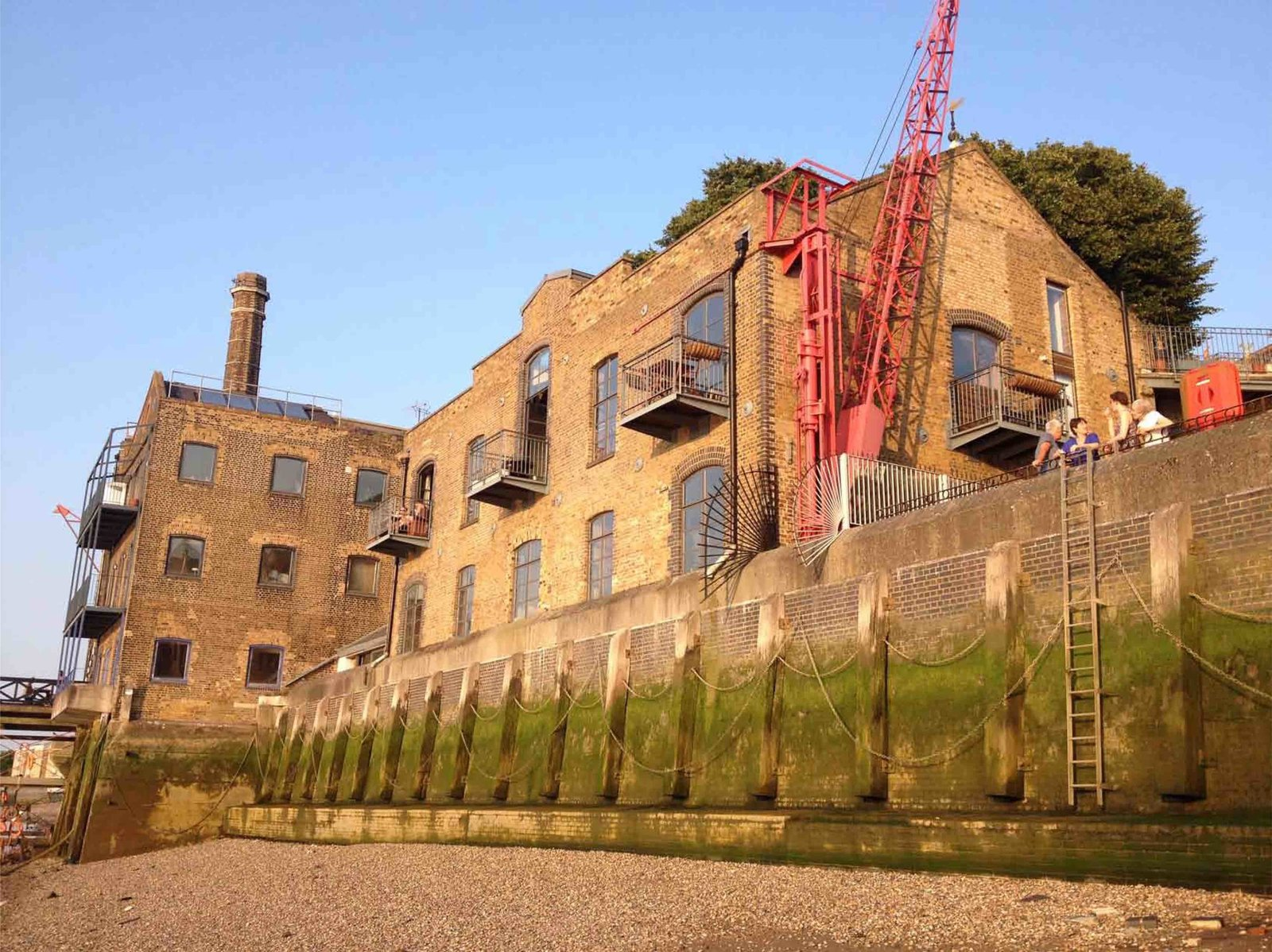 Tagged: Exterior, Apartment, Gable RoofLine, and Brick Siding Material.  Photo 2 of 12 in An Old Grain Warehouse on the River Thames Is Transformed Into an Industrial-Modern Home
