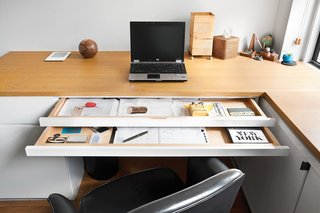 4 Decluttering Tips From Organizing Master Marie Kondo - Photo 2 of 4 - In the home office of a Manhattan studio apartment, each of the sliding trays in the office desk serves a different function.