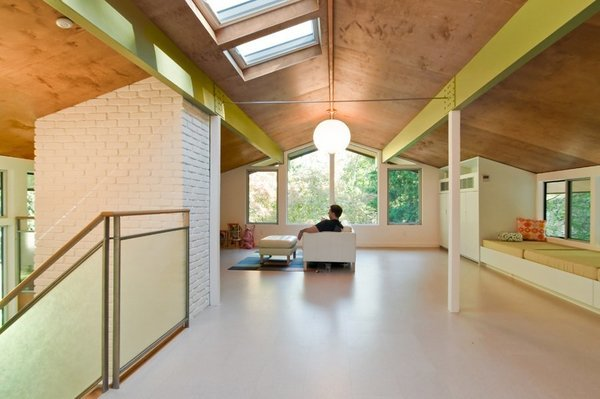 """One of the first homes built in Tuxedo Park, New York, was this """"Techbuilt House"""" designed by prefab pioneer Carl Koch, with plywood interior finishings."""