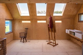 10 Prefabricated or Modular Structures That Use Plywood in Creative Ways - Photo 9 of 11 - The interior of Midden Studio in Scotland is lined with plywood.