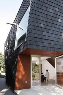 """These 9 Structures Prove That Shingle Exteriors Can Be Surprisingly Modern - Photo 6 of 9 - In Buffalo, New York, architect Adam Sokol designed """"Birdhouse,"""" a house with a black facade composed of shingles made out of locally recycled rubber."""