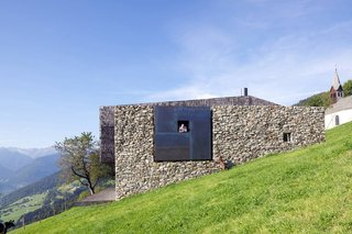 These 9 Structures Prove That Shingle Exteriors Can Be Surprisingly Modern - Photo 7 of 9 - On the site of old farmhouse ruins in Italy, architecture firm Bergmeister Wolf Architekten built a new section with concrete, weathered steel, and wood shingles to contrast with the old stones.