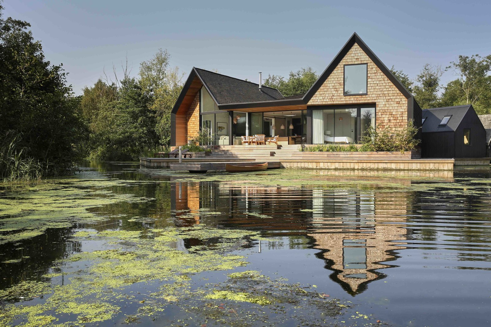 This RIBA award-winning house by Platform 5 Architects has three shingle-clad pitch roof bays that are influenced by Scandinavian lake houses and echoes the form of the local boat sheds. Tagged: Exterior, House, Shingles Roof Material, and Wood Siding Material.  Best Photos from 9 Traditional-Turned-Modern Cottages You Can Rent in the UK
