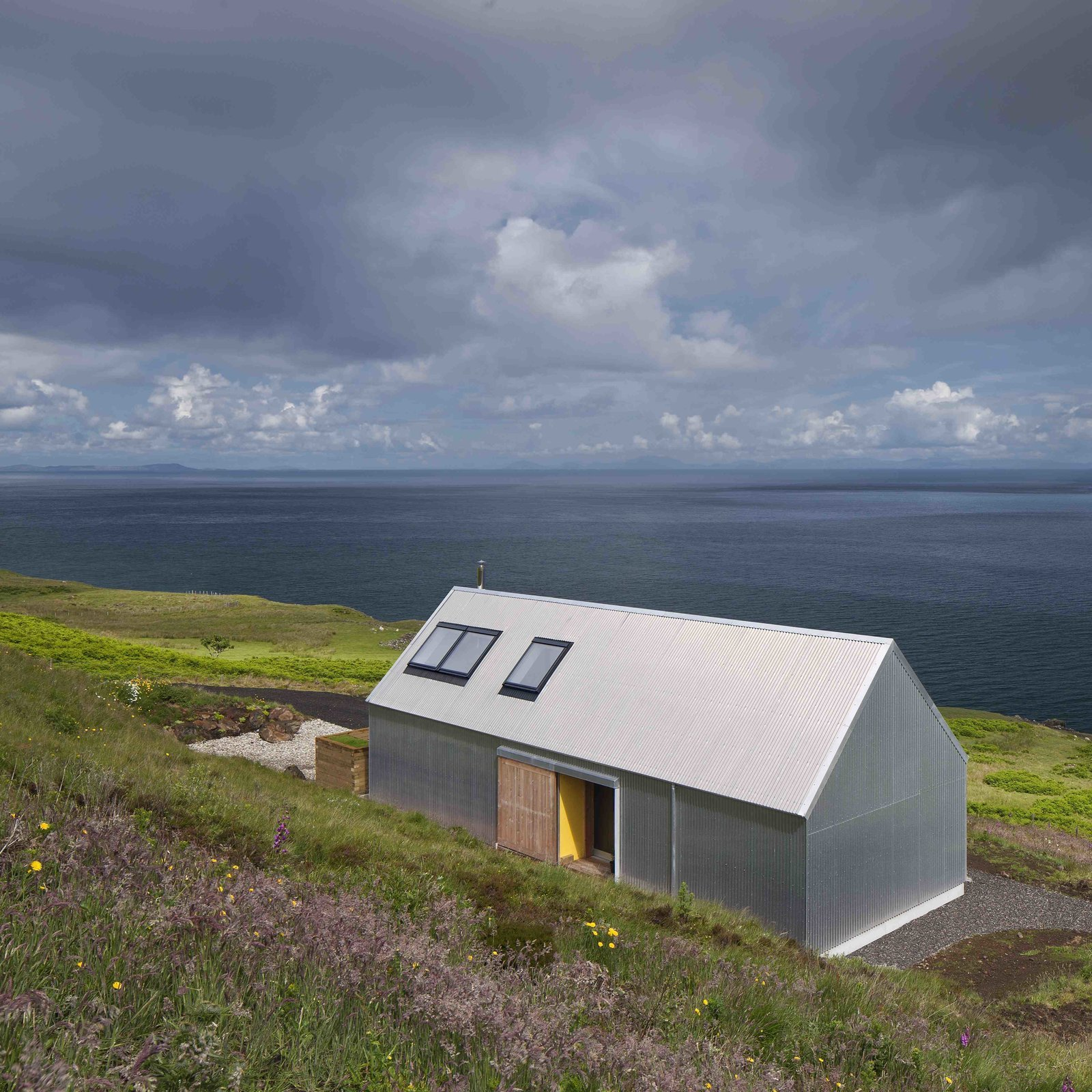 Though not made of stone or brick like the other holiday homes, this two-person escape on Scotland's picturesque Isle of Skye, designed by Rural Design Architects was made with corrugated metal, a material that is commonly used for agricultural sheds or Tagged: Exterior, House, Metal Siding Material, and Metal Roof Material.  Best Photos from 9 Traditional-Turned-Modern Cottages You Can Rent in the UK