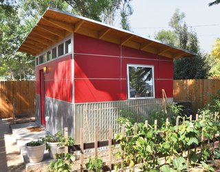 8 Tiny Sheds and Studios Used as Home Offices or Creative Retreats - Photo 8 of 8 - When a Colorado web designer's newborn daughter was given his home office, he moved his workspace to this quaint shed made with ruby-red Collins Truwood Siding and corrugated metal.