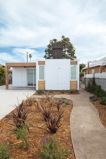 7 Coolest California Prefabs - Photo 3 of 7 - A collaboration between Minarc and Habitat for Humanity, this low-cost, net-zero home in South Central L.A. was built with unembellished cement-board cladding and Minarc's signature mnmMOD panels.