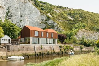 7 Modern Modular and Prefabricated Homes in the UK - Photo 1 of 7 - This 2,808-square-foot, Cor-Ten steel house in Lewes, East Sussex, was prefabricated off-site and features a building shell made out of SIPs (structured insulated panels).