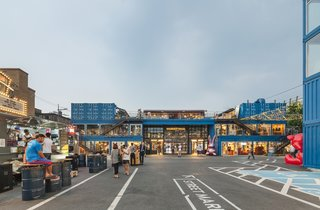 Dwell's Top 10 Upcycled Shipping Containers of 2017 - Photo 1 of 10 - Common Ground is a dynamic mall in Seoul made out of 200 bright blue, stacked prefabricated container modules. The 57,048-square-foot building, which took only five moths to construct is home to a variety of retail stores and F&B outlets that frequently draw a lively crowd.