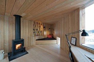 9 Small Studios Where Writers and Artists Can Get Creative - Photo 1 of 9 - This 172-square-foot cabin by Oslo-based architects Jarmund/Vigsnæs AS Arkitekter MNAL has boundaries that are defined by an underground pipeline, as well as the height lines of the terrain. The cabin has windows and doors that are strategically positioned to prevent people from being able to look inside it, while offering the writer scenic views of the outdoors.