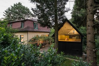 9 Small Studios Where Writers and Artists Can Get Creative - Photo 2 of 9 - This 1930s black timber shed near the town of Eichgraben in Austria was converted by Vienna practice Franz & Sue into a writing studio, playhouse, and guest room. It's accessed through a trapdoor, with a fully glazed gable that looks out to the treetops.