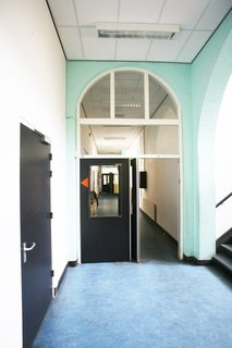 An Old Amsterdam School Is Converted Into 10 Apartments - Photo 6 of 15 - Details of the original school.