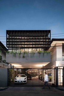 102 Potted Plants Are Part of This Thai Home's Facade