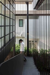 102 Potted Olive Plants Cover the Facade of This Bangkok Home - Photo 2 of 11 -