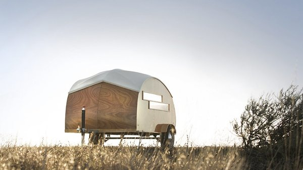 Built with modernist industrial techniques, this tiny 44-square-foot, teardrop-shaped hybrid prefab trailer has a boat-like shell, that was built with lightweight frame enclosed with taut fabric and sheets of Jobert Okume marine plywood.