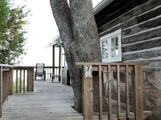 Enjoy the Rest of Fall by Renting One of These Cozy Cabins or Tree Houses - Photo 16 of 17 - With light wooden walls and a simple gray-and-white color scheme, this four-bedroom cabin from the 1930s in the heart of Osage Beach is full of Scandinavian charm.
