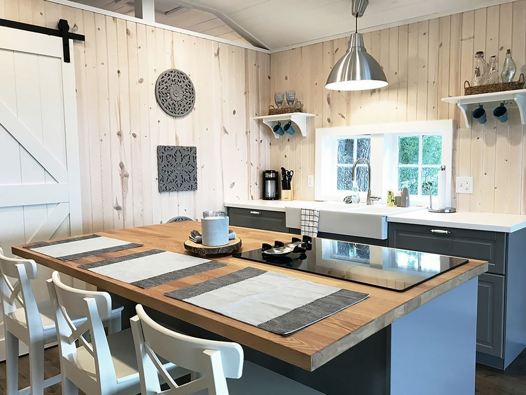 With light wooden walls and a simple gray-and-white color scheme, this four-bedroom cabin from the 1930s in the heart of Osage Beach is full of Scandinavian charm.