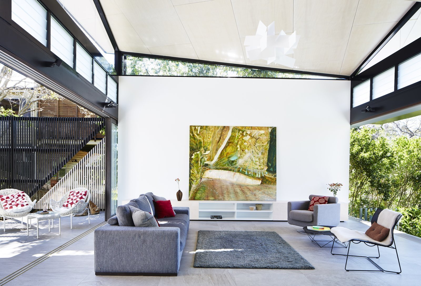 Tagged: Living Room, Sofa, Chair, Rug Floor, Console Tables, Coffee Tables, End Tables, and Pendant Lighting.  Best Photos from 9 Best Homes With Interesting Screened Facades