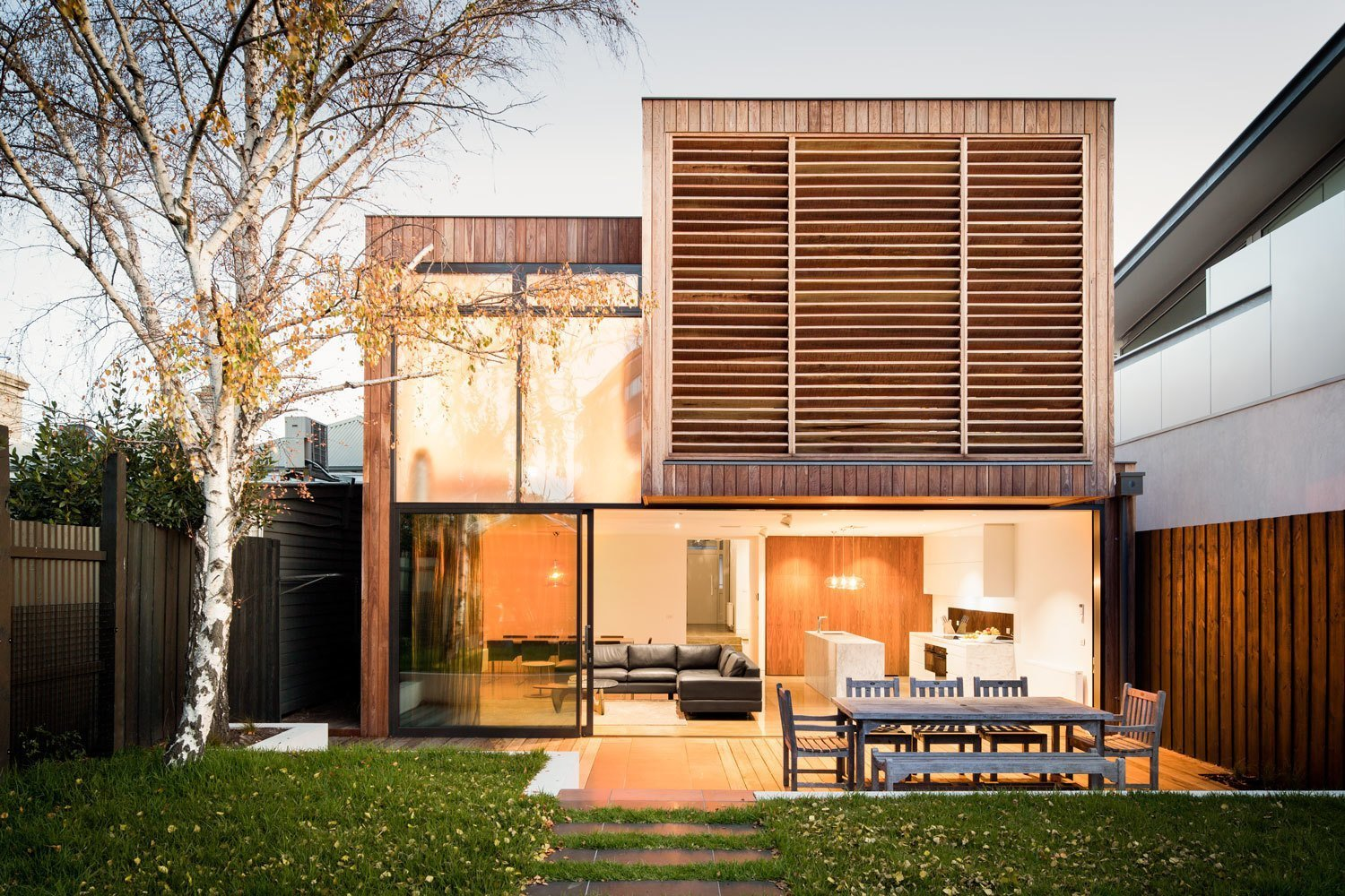 To create the feel of a seaside retreat, Mitsuori Architects included Australian Ironbark wood slats on the rear-facing wall of this rorenovated this Victoiran heritage home in Melbourne. Ironbark is an incredibly durable hardwood that turns a beautiful silvery-gray as it weathers over time. Tagged: Exterior, House, Wood Siding Material, and Flat RoofLine.  Photo 8 of 19 in 9 Best Homes With Interesting Screened Facades