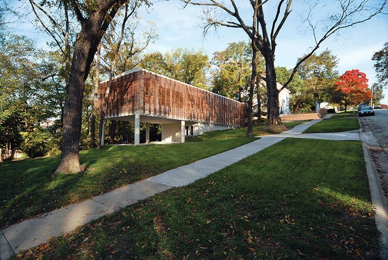 To tackle the challenges of a steep slopping site and a tight budget, architect Dan Rockhill used a slatted exterior screen of Cumaru wood to shields inexpensive metal sidings for this Kansas home. Tagged: Exterior, Metal Siding Material, and House.  Best Photos from 9 Best Homes With Interesting Screened Facades
