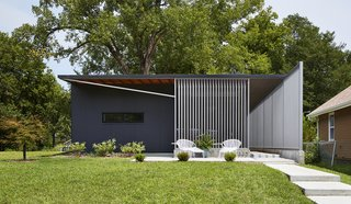 9 Best Homes With Interesting Screened Facades - Photo 15 of 18 - Using insulated metal panels that were rejected from the construction of a tennis center nearby, this sustainable home in Kansas by Studio 804 was inspired by the prefab Lustron houses that were developed in the United States after World War II.