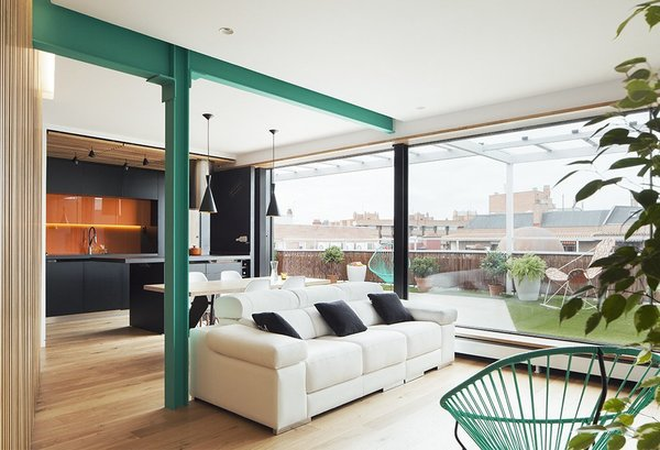 To free this 753-square-foot penthouse apartment in Madrid from a cramped layout, Daniel Bergman Vázquez, a partner at Estudio Untercio reconfigured the space and created an open-plan living area which connects to terrace.