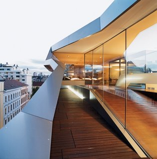 8 Best Dwell Penthouses - Photo 8 of 17 - Using a lightweight, steel-skeleton construction, Vienna architect Delugan Meissl boldly inserted this dazzling Vienna penthouse in-between the traditional rooftops of old buildings in the city's Wieden district.