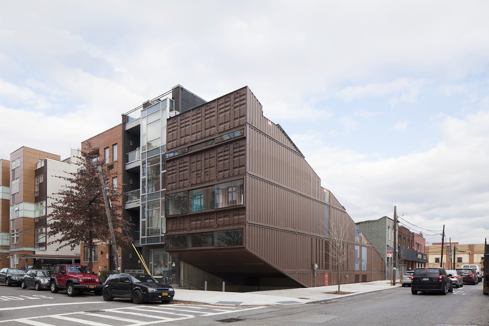 Sited on a typical 25-by-100-foot corner lot in Brooklyn's Williamsburg neighborhood, this 5,000-square-foot residence was built with 21 stacked shipping containers cut diagonally along the top and bottom to create a step-like structure with four tiered levels and a small pool between the two lower levels.  Designed by LOT-EK, the construction process optimized the use of shipping containers by recombining all the leftovers from creating the diagonal cut. Tagged: Exterior, House, Shipping Container Building Type, and Metal Siding Material.  Photo 2 of 13 in An Amazing Home in Brooklyn Made Out of 21 Shipping Containers