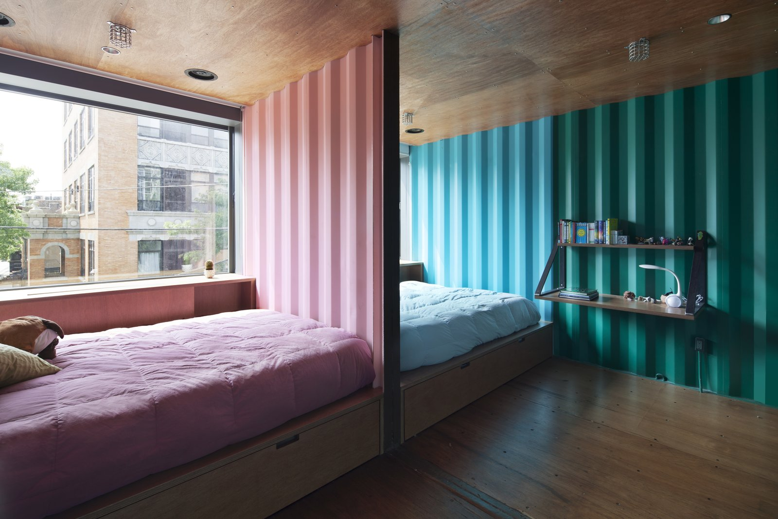 Tagged: Bedroom, Bed, Shelves, Recessed Lighting, and Medium Hardwood Floor.  Photo 10 of 13 in An Amazing Home in Brooklyn Made Out of 21 Shipping Containers