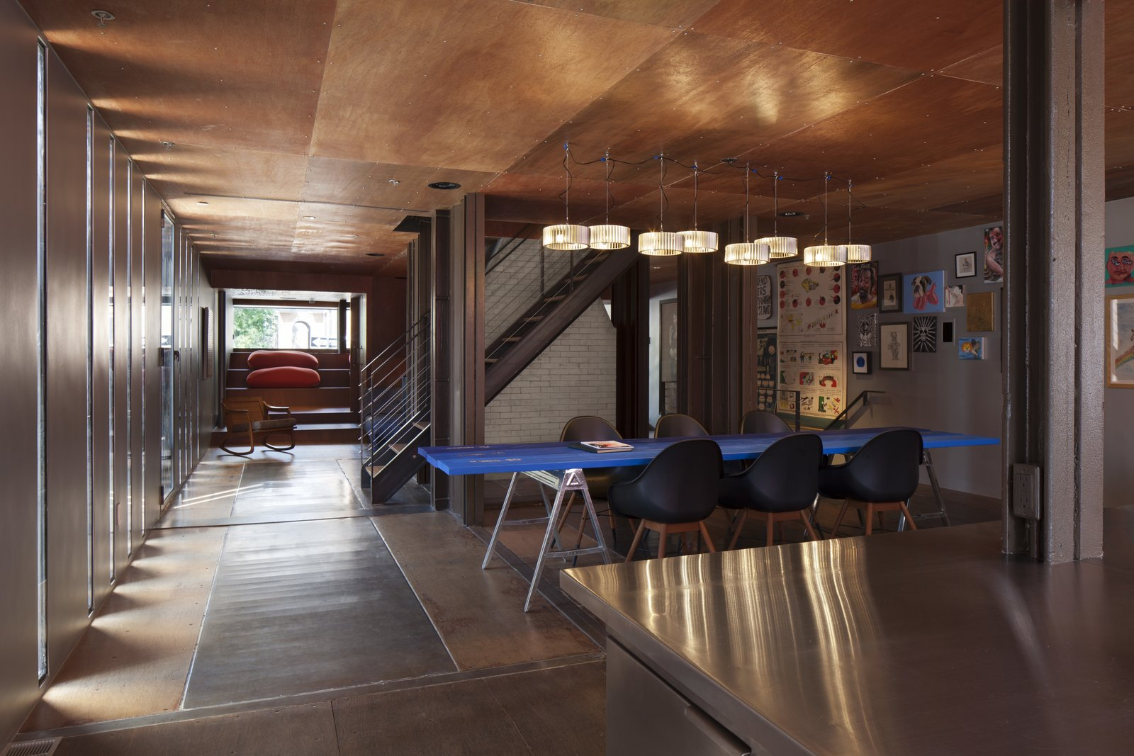 Tagged: Dining Room, Table, Chair, Pendant Lighting, and Medium Hardwood Floor.  Photo 6 of 13 in An Amazing Home in Brooklyn Made Out of 21 Shipping Containers