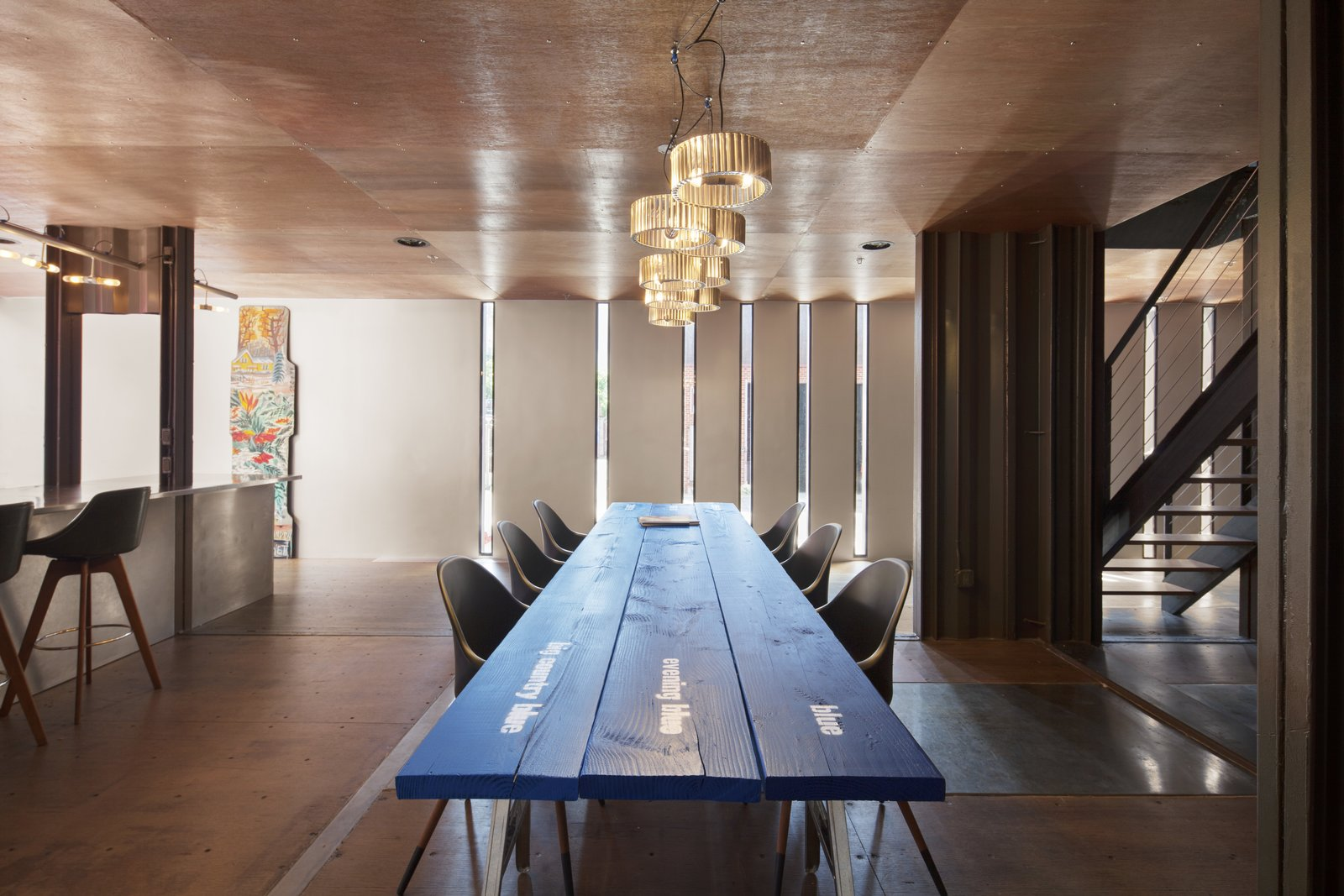 Tagged: Dining Room, Medium Hardwood Floor, Pendant Lighting, Chair, Table, Stools, and Bar.  Photo 11 of 13 in An Amazing Home in Brooklyn Made Out of 21 Shipping Containers