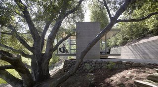 6 Tiny Outdoor Pavilions Inspired by Japanese Tearooms - Photo 3 of 12 - Designed by California-based architects Swatt Miers, these three teahouses on a private property were conceived as spaces outside the main home that would be free from the distractions of internet, telecommunications, and television. The largest of the three pavilions is used as a workspace, the second as a bedroom, and the third as a meditation pavilion.
